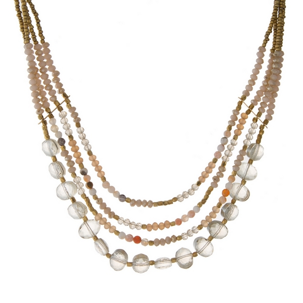 "Gold tone necklace with layers of ivory faceted beads. Approximately 16"" in length."