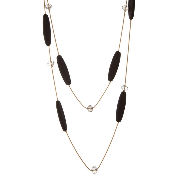 """Gold tone two layer necklace with brown wooden beads and clear faceted bead accents. Approximately 24"""" and 32"""" in length."""