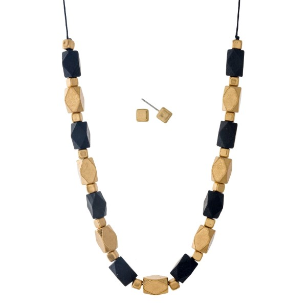 """Black cord necklace set with black and gold beads. Approximately 32"""" in length."""