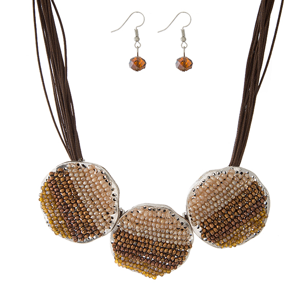 """Brown waxed cord necklace set with three brown and topaz beaded circles, and matching fishhook earrings. Approximately 16"""" in length."""