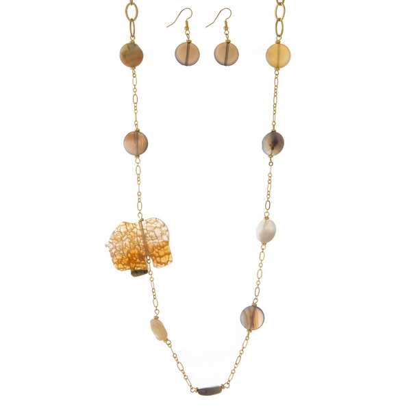 """Gold tone necklace set with beige and gray natural stones and a brown elephant pendant. Approximately 34"""" in length."""