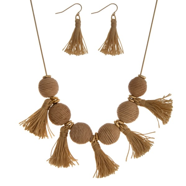"""Gold tone necklace set with beige thread wrapped balls and tassel accents. Approximately 16"""" in length."""