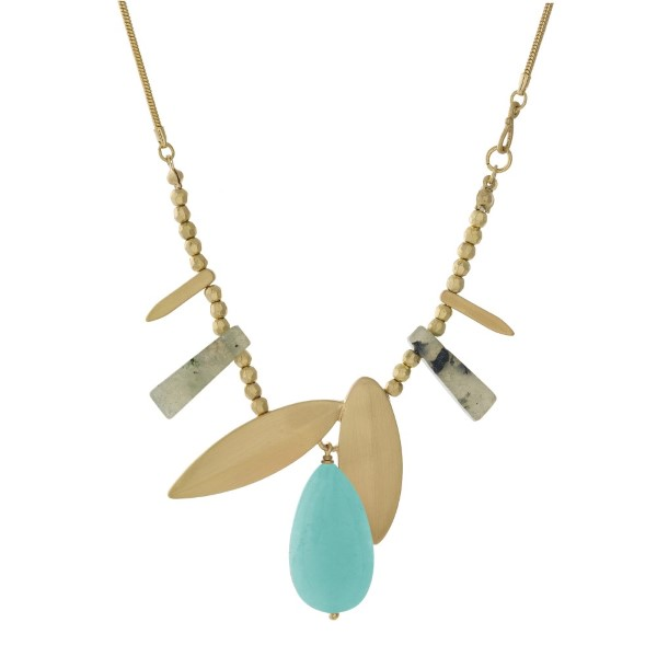 """Gold tone necklace with pink and mint green stone pendants. Approximately 32"""" in length."""