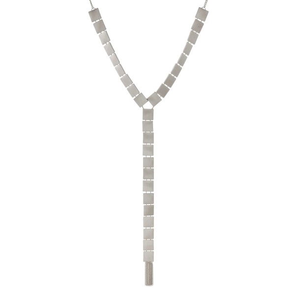 """Silver tone 'Y' necklace with square shapes and metal fringe. Approximately 24"""" in length."""