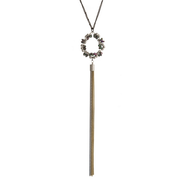"""Black and gold tone necklace with a beaded circle pendant and chain tassel. Approximately 30"""" in length."""