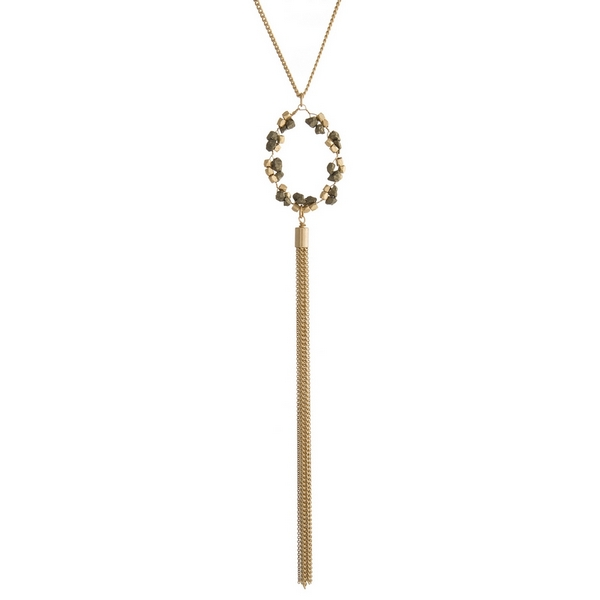 "Gold tone necklace with a pyrite beaded circle pendant and a chain tassel. Approximately 24"" in length."