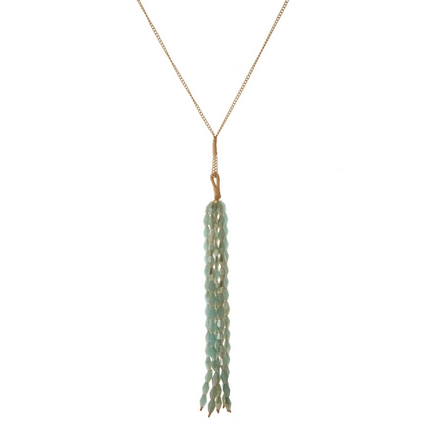 "Gold tone necklace with a mint green faceted bead tassel pendant. Approximately 30"" in length."