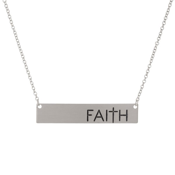 "Dainty silver tone necklace with a bar pendant, stamped with ""Faith."" Approximately 16"" in length."