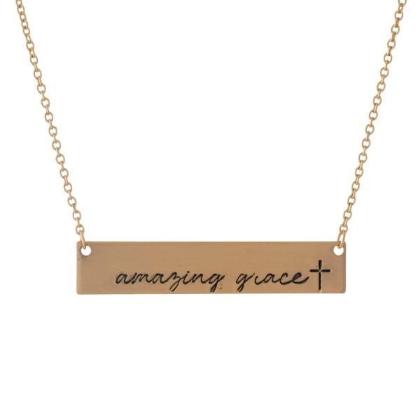 "Dainty gold tone necklace with a bar pendant, stamped with ""Amazing Grace."" Approximately 16"" in length."