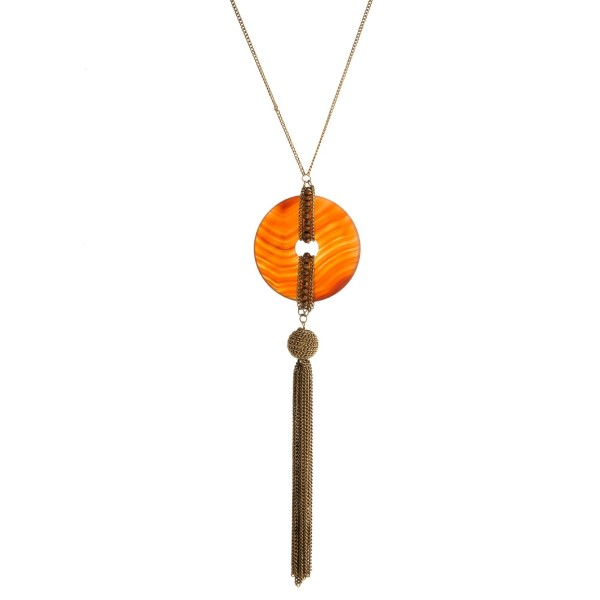 "Burnished gold tone necklace with a natural stone pendant and chain tassel. Approximately 30"" in length."