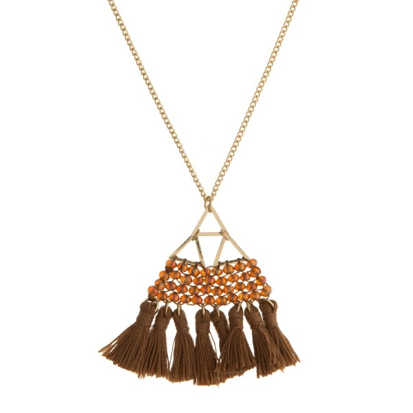 "Dainty gold tone necklace with a beaded and fan tassel pendant. Approximately 26"" in length."
