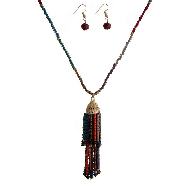 "Beaded necklace set with a tiered tassel pendant and matching fishhook earrings. Approximately 32"" in length."