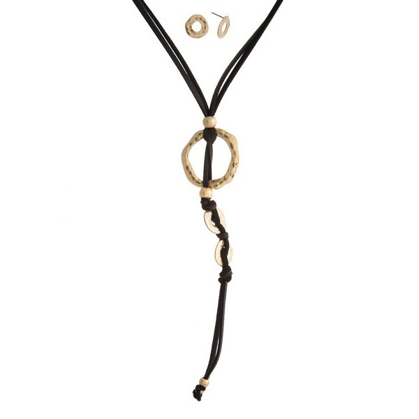 """Faux suede necklace set with an open circle pendant, tassel accent, and matching stud earrings. Approximately 24"""" in length."""