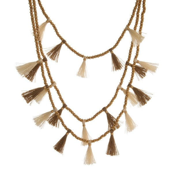 "Three layer, beaded necklace with gold tone accents and thread tassels. Approximately 16"" to 26"" in length."