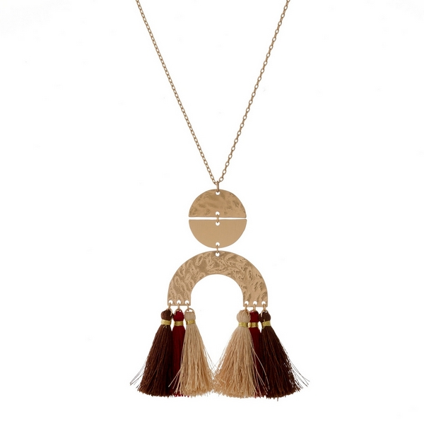 "Gold tone necklace with geometric shapes and thread tassels. Approximately 30"" in length."