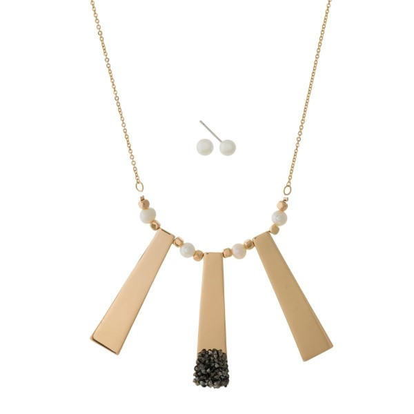 "Dainty necklace set with three metal pendants, pearl beads and hematite accents. Approximately 18"" in length."