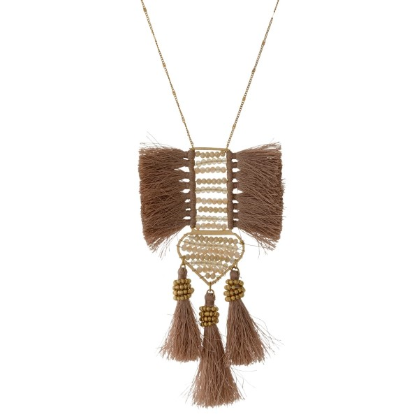 "Gold tone necklace with a beaded and thread tassel pendant. Approximately 30"" in length."