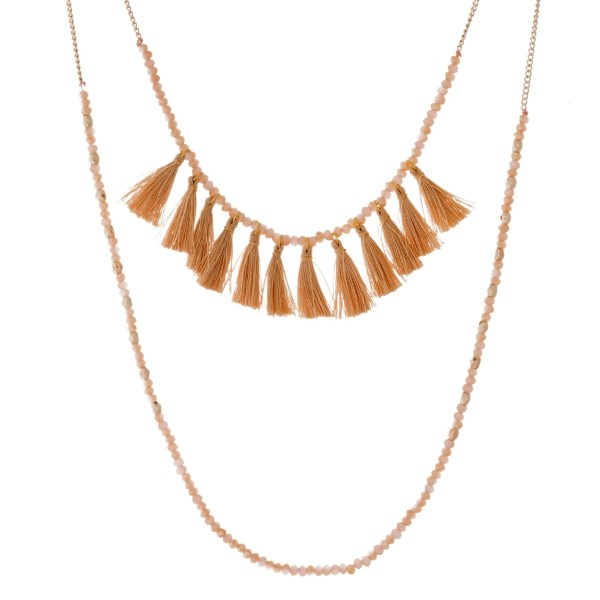 "Rose gold tone, two layer necklace with topaz beads and thread tassels. Approximately 28"" and 30"" in length."