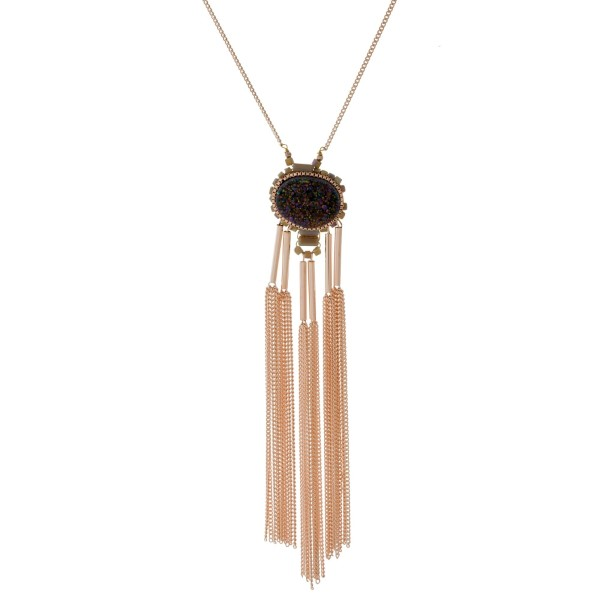 "Long, metal necklace with a natural druzy pendant and chain tassels. Approximately 30"" in length."