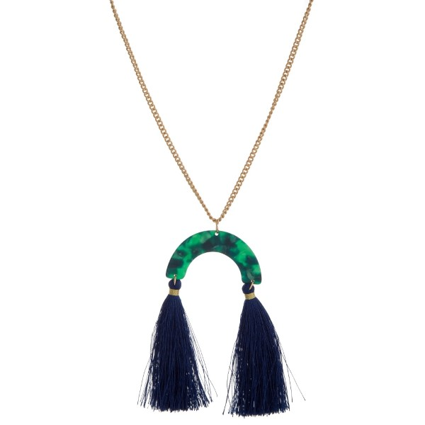 "Gold tone necklace with an acetate pendant and thread tassels. Approximately 30"" in length."