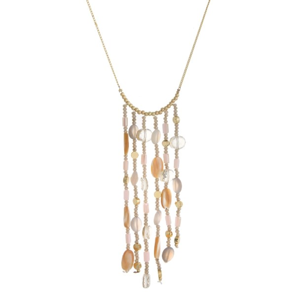 "Long, dainty necklace with a horizontal beaded tassel. Approximately 26"" in length."