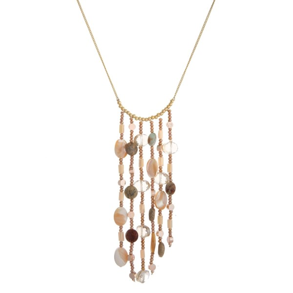 """Long, dainty necklace with a horizontal beaded tassel. Approximately 26"""" in length."""