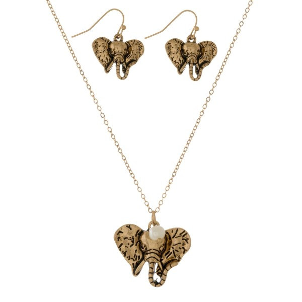 """Dainty necklace set with an elephant head pendant and matching fishhook earrings. Approximately 16"""" in length."""