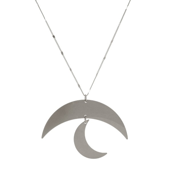 """Long, metal necklace with a moon pendant. Approximately 30"""" in length."""