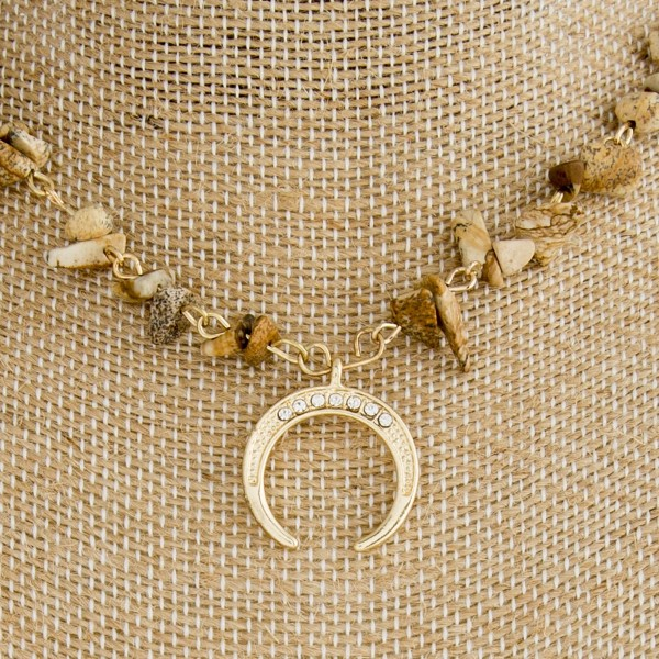 """Gold tone necklace with natural stone beads and horn detail. Approximately 16"""" in length."""