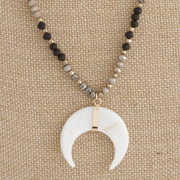 """Short beaded boho necklace with horn pendant. Approximately 18"""" in length."""