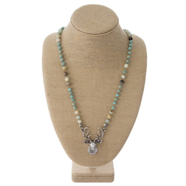 """Long beaded necklace with metal deer pendant. Approximately 30"""" in length."""