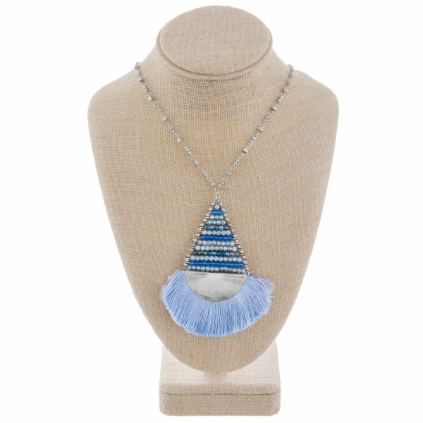 """Long metal drop necklace with fanned tassel. Approximate 26"""" in length and 4"""" pendant."""