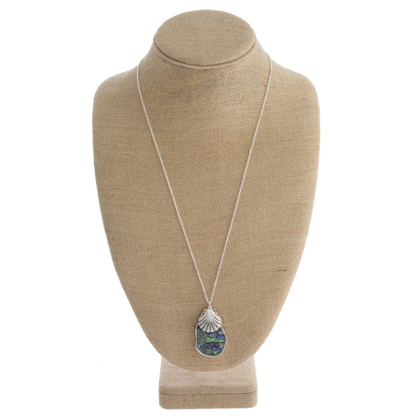 """Long necklace with abalone pendant and clamshell pendant. Approximate 27"""" in length with 2"""" pendant."""
