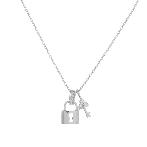 """Gold dipped necklace with small key and lock pendant. Approximate 20"""" in length with 0.5"""" pendant."""