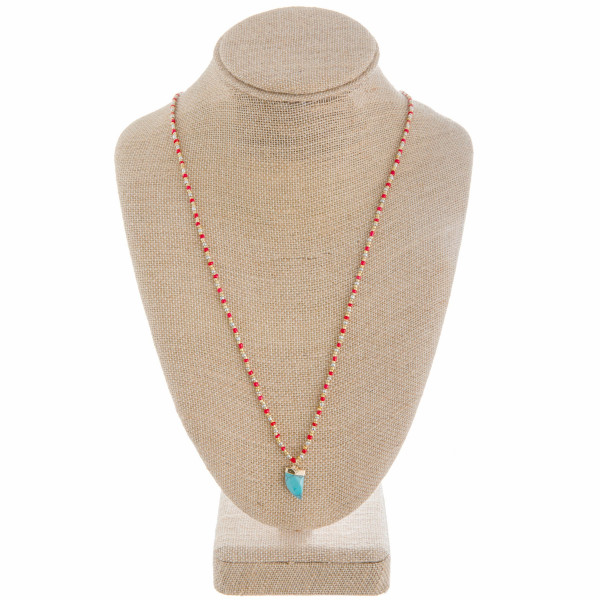 """Long beaded necklace with natural stone pendant. Approximate 34"""" in length."""