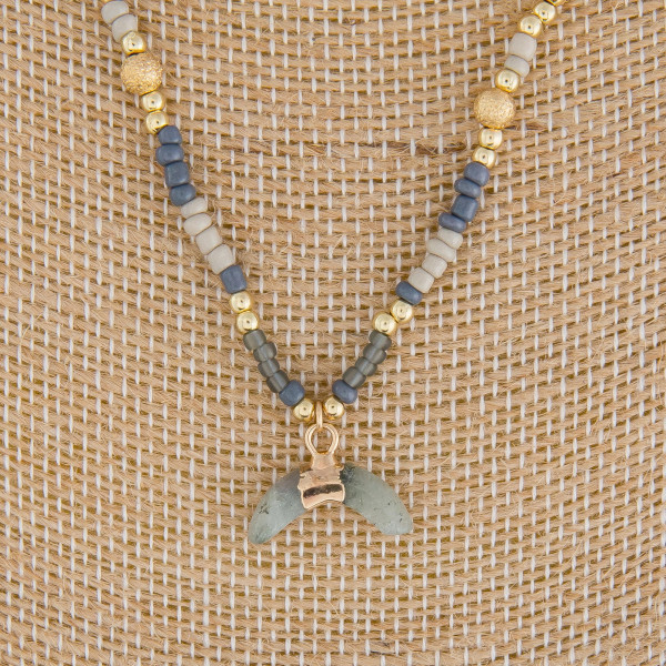 """Long metal necklace with beads and horn pendant. Approximate 16"""" in length."""