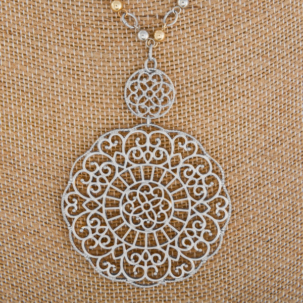 """Long metal chain-linked necklace with filigree pendant. Approximate 38"""" in length."""