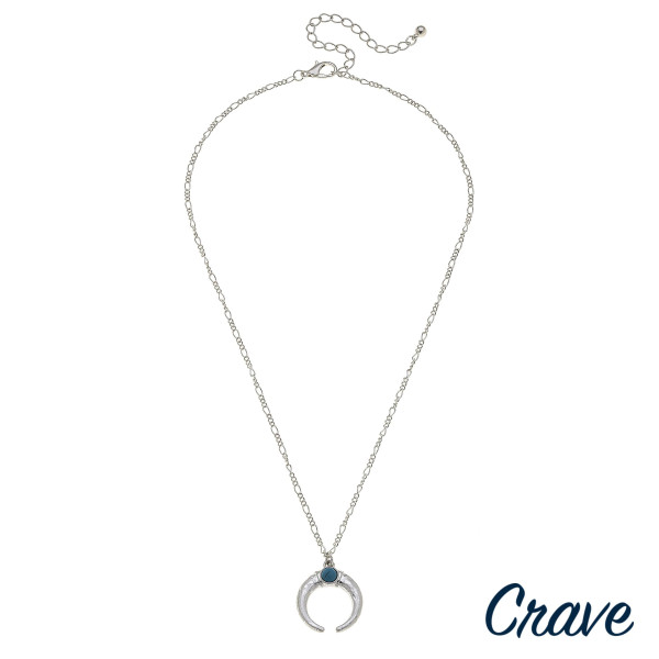 """Long metal crave necklace with crescent pendant. Approximate 26"""" in length."""