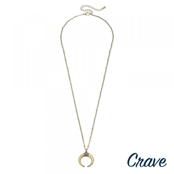 """Long metal crave necklace with crescent pendant. Approximate 32"""" in length."""