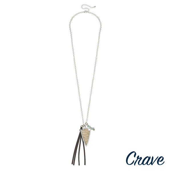 """Long metal necklace with arrow pendant and tassel details with natural stones. Approximate 18"""" in length."""