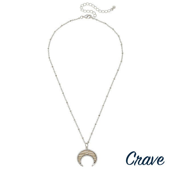 """Long metal crave necklace with crescent pendant. Approximate 24"""" in length."""