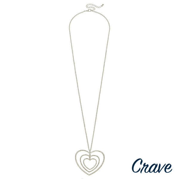 """Long metal necklace with double heart pendant. Approximate 32"""" in length."""