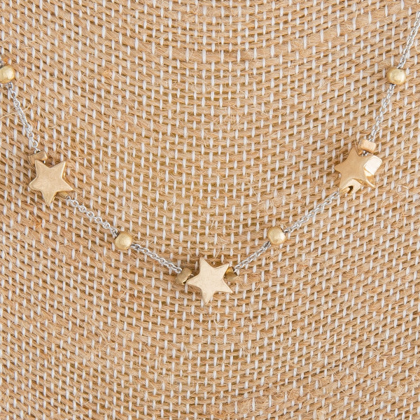 "Long metal necklace with stars. Approximate 36"" in length."