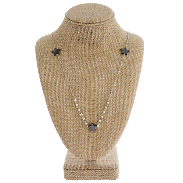 "Long chain necklace featuring square beads and star accents. Approximately 31"" in length."