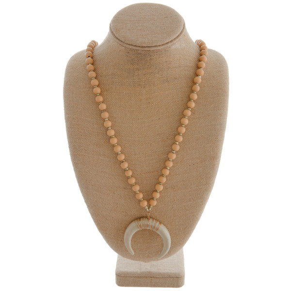 """Long beaded necklace featuring a crescent pendant and gold accents. Approximately 40"""" in length. Pendant is approximately 2"""" in diameter."""