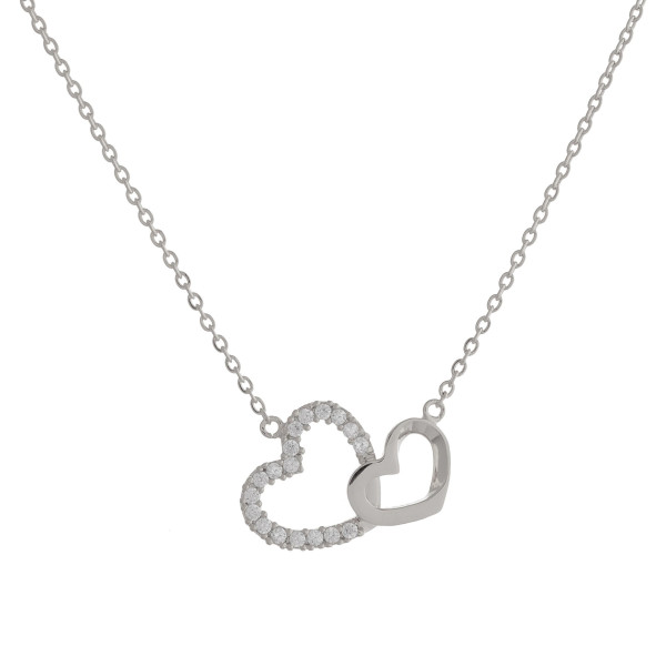 "Short metal necklace with double heart pendant. Approximate 15"" in length."