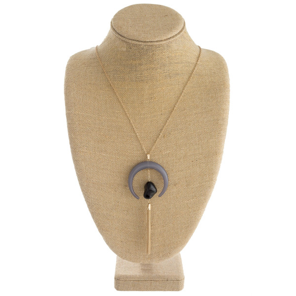 """Long cable chain necklace featuring a large crescent pendant, a natural stone accent, and a gold chain tassel. Crescent pendant is 2"""" in diameter. Approximately 36"""" in length overall."""