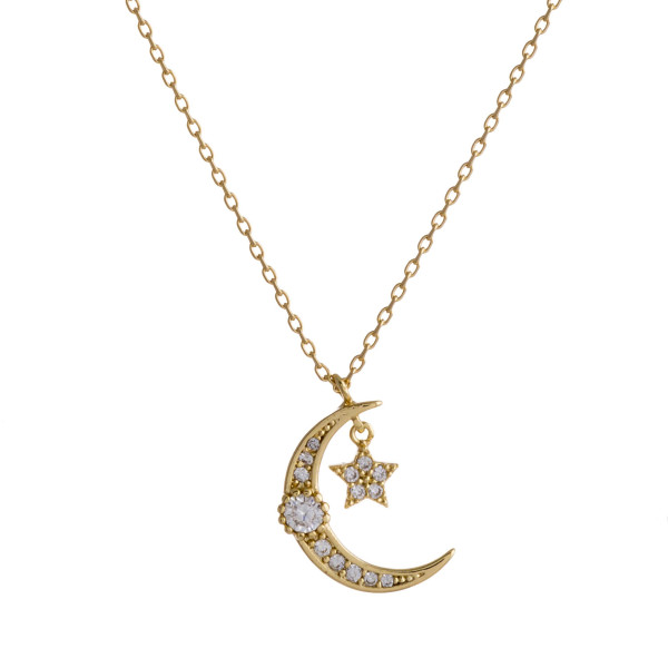 """Dainty gold chain necklace featuring a cubic zirconia adorned crescent pendant and a star accent. Approximately 18"""" in length. Pendant is approximately 1"""" in diameter."""