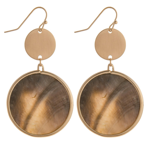 "Long black mother of pearl circular earrings with brass detail. Measures approximately 2"" long."