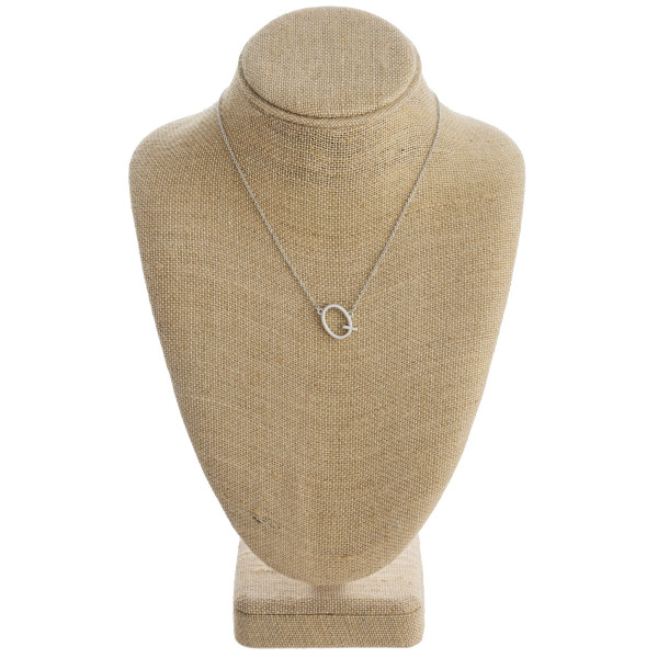 """Silver metal necklace featuring the initial """"Q"""". Approximately 16"""" in length."""